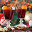 Two glasses of mulled wine with Christmas lights in the backgrou — Stock Photo