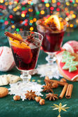 Two glasses of mulled wine, cookies and variation of Christmas s — Stock Photo