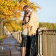 Royalty-Free Stock Photo: Couple in love tenderly hugging on the Fontanka embankment in Sa