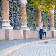 Couple walking by beautiful grill of Mikhailovsky (Michael) — Stock Photo #13696975