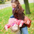Mother and daughter having fun outdoors — Stock Photo #13697246