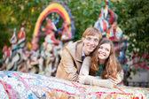 Positive young couple having fun outdoors — Stock Photo