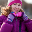 Beautiful young girl in bright winter clothes — Stock Photo #13809096
