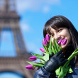 Portrait of cheerful young lady in Paris with bunch of fresh spr — Stock Photo