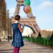 Girl in bright clothes with colourful balloons in Paris near the — Stock Photo #13809103
