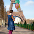 Girl in bright clothes with colourful balloons in Paris near the — Stock Photo