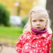 Outdoor autumn portrait of little girl — Stock Photo