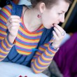 Young girl in bright clothes eating raspberry — Stock Photo