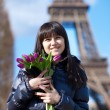 Happy beautiful girl with tulips enjoying spring day in Paris — Stock Photo #13809141