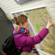 Tourist girl in Parisian metro, looking at the map — Stock Photo