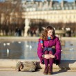 Pretty young girl in bright clothes in the Tuilleries garden in — Stock Photo #13809148