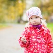 Outdoor autumn portrait of thoughtful little girl — Stock Photo