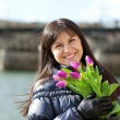 Happy beautiful girl with tulips enjoying spring day in Paris — Stock Photo