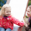 Mother and daughter together on playground — Stock Photo #13809283