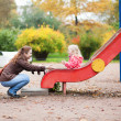 Mother and daughter having fun together on playground — Stock Photo