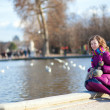 Smiling young girl in Tuilleries park of Paris — Stock Photo