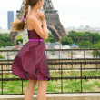 Young beautiful girl in Paris, looking at the Eiffel Tower — Stock Photo #13809330