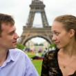 Romantic couple in Paris near the Eiffel Tower — Stock Photo