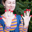 Beautiful young girl in bright clothes poses as Amelie with rasp — Stock Photo #13809373