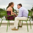 Romantic couple in Paris, sitting on green chairs in Tuileries g — Foto de Stock