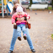 Mother and daughter having fun outdoors — Stock Photo #13809394