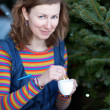 Beautiful girl in bright clothes drinking coffee in a Parisian s — Stock Photo #13809413
