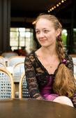 Beautiful young woman in Parisian street cafe — Stock Photo