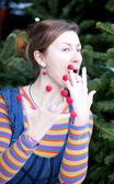 Beautiful young girl in bright clothes poses as Amelie with rasp — Stock Photo