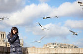 Happy brunette girl in Paris enjoying windy spring day — Stock Photo
