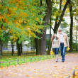 Happy young couple enjoying beautiful autumn day - Stock Photo