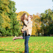 Young happy loving couple having fun on a fall day — Stock Photo