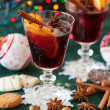 Two glasses of mulled wine with variation of spices — Stock Photo