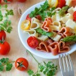 Stock Photo: Romantic dinner. Delicious heart-shaped pasta with tomatoes, asp