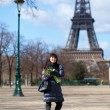 Stock Photo: Cheerful beautiful tourist in Paris