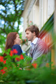 Man and woman together on balconyof their house or hotel — Stock Photo