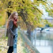 Beautiful blond girl on Swan island near the Eiffel tower in Par - Stock Photo