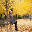 Pretty young girl enjoying a beautiful autumn day in Paris — Stock Photo