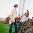 Cheerful young couple having a date in park — Stock Photo #15333311
