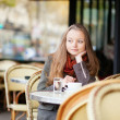 Thoughtful young girl in an outdoor cafe in Paris — Stock Photo