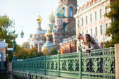 Dating couple on a bridge near the Church of the Savior on Blood — Stock Photo