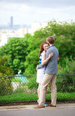 Sensual romantic couple is hugging in park on Montmartre in Pari — Stock Photo