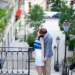Beautiful couple kissing at the stairs on Montmartre in Paris — Stock Photo