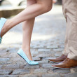 Male and female legs during a date — Stock Photo