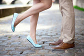 Male and female legs during a date — Foto Stock