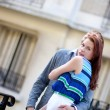 Beautiful romantic couple hugging on the street — Foto de Stock