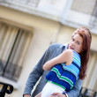 Beautiful romantic couple hugging on the street — Stock Photo