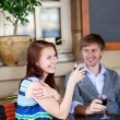 Beautiful couple drinking red wine in a cafe — Stock Photo #18187555
