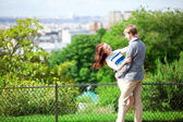 Happy couple is hugging on Montmartre with nice view on Paris — Stock Photo