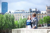 Romantic dating couple in Paris at the bridge — Stock Photo