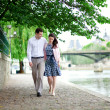 Romantic dating couple is walking by the water in Paris — Stock Photo